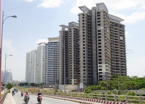 Thị trường địa ốc thêm khó khăn vì áp lực thoái vốn
